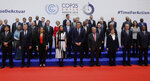 Spain's caretaker Prime Minister Pedro Sanchez, centre, and Secretary-General of the United Nations António Guterres, pose for a photo with the rest of representatives taking part at the COP25 climate talks summit in Madrid, Monday Dec. 2, 2019. The chair of a two-week climate summit attended by nearly 200 countries warned at its opening Monday that those refusing to adjust to the planet's rising temperatures