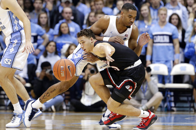 North Carolina forward Garrison Brooks, rear, pressures Gardner-Webb guard Lance Terry (0) during the first half of an NCAA college basketball game in Chapel Hill, N.C., Friday, Nov. 15, 2019. (AP Photo/Gerry Broome)