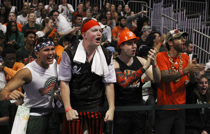 UM fans cheer the team, during a first round women's college basketball game against FGCU, in the NCAA Tournament in Friday, March 22, 2019, in Coral Gables, Fla. (AP Photo/Luis M. Alvarez)