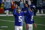 New York Giants place kicker Graham Gano (5) celebrates kicking a field goal as punter Riley Dixon (9) stands by in the second half of an NFL football game against the Dallas Cowboys in Arlington, Texas, Sunday, Oct. 11, 2020. (AP Photo/Michael Ainsworth)
