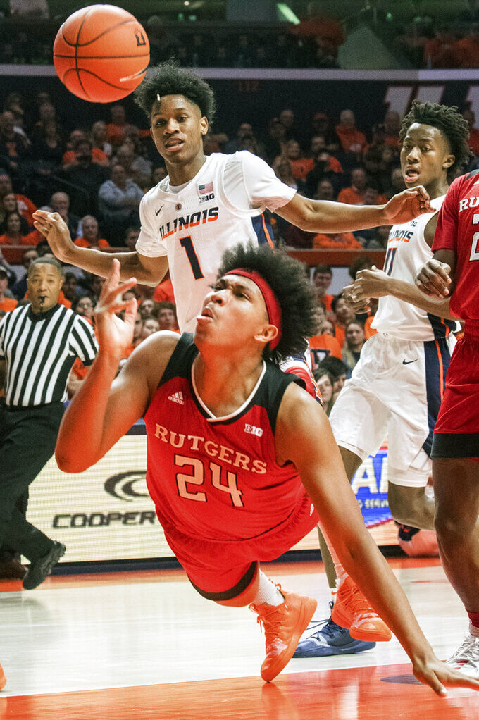 Rutgers forward Ron Harper Jr. (24) attempts to shoot as he falls during of an NCAA college basketball game against Illinois in Champaign, Ill., Saturday, Feb. 9, 2019. (AP Photo/Robin Scholz)