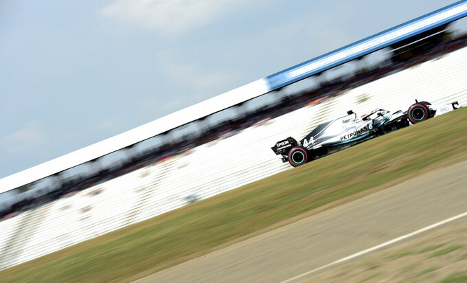 Mercedes driver Lewis Hamilton of Britain steers his car during the second Formula One practice session at the Hockenheimring racetrack in Hockenheim, Germany, Friday, July 26, 2019. The German Formula One Grand Prix will be held on Sunday. (AP Photo/Jens Meyer)