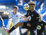 CF Montreal's Zorhan Bassong, right, challenges Chicago Fire FC's Boris Sekulic during first half MLS soccer action in Montreal, Sunday, Sept. 19, 2021. (Graham Hughes/The Canadian Press via AP)