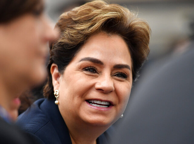 FILE - In this Saturday, Nov. 11, 2017 file photo, Patricia Espinosa, executive secretary of the United Nations Framework Convention on Climate Change, smiles in the U.S. Climate Action Center during the