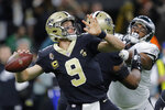 FILE - In this Jan. 13, 2019, file photo, New Orleans Saints quarterback Drew Brees (9) throws against the Philadelphia Eagles, during an NFL football game in New Orleans. The Saints have no time to waste if they want to win another Super Bowl with record-setting quarterback Drew Brees under center _ which is why three of their top four 2019 draft slots have already been traded away.  The Saints aren't slated to pick until late in the second round _ 62nd overall _ because they largely mortgaged the top of this year's draft in hopes of winning it all last season.   (AP Photo/Gerald Herbert, File)