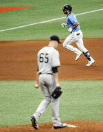 New York Yankees starter James Paxton (65) walks the mound after giving up a solo home run to Tampa Bay Rays' Brandon Loew, top, during the seventh inning of a baseball game Sunday, Aug. 9, 2020, in St. Petersburg, Fla. (AP Photo/Steve Nesius)