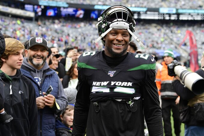 FILE - In this Nov. 10, 2019, file photo, New York Jets running back Le'Veon Bell (26) smiles before an NFL football game against the New York Giants, in East Rutherford, N.J. Bell has his sights set on a big-time bounce back. The New York Jets star running back put up pedestrian numbers last season after sitting out a year in a contract dispute with the Pittsburgh Steelers. Bell say he's now in the best shape of his career and can't wait to show it on the field. AP Photo/Steven Ryan)