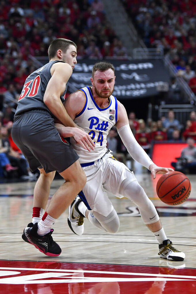 Pittsburgh guard Ryan Murphy (24) fights to get around the defense of Louisville guard Ryan McMahon (30) during the first half of an NCAA college basketball game in Louisville, Ky., Friday, Dec. 6, 2019. (AP Photo/Timothy D. Easley)