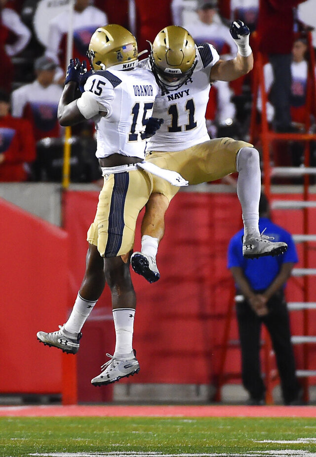 Navy safety Evan Fochtman (11) celebrates his interception with Noruwa Obanor during the second half of an NCAA college football game against Houston, Saturday, Nov. 30, 2019, in Houston. (AP Photo/Eric Christian Smith)