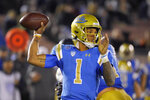 FILE - In this Nov. 30, 2019, file photo, UCLA quarterback Dorian Thompson-Robinson passes during the second half of the team's NCAA college football game against California in Pasadena, Calif. UCLA faces Colorado this week. Thompson-Robinson ran for 200 yards and threw for 226 more the last time the teams played. (AP Photo/Mark J. Terrill, File)