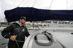 Skipper Boris Herrmann works on the boat Malizia as it is moored in Plymouth, England Tuesday, Aug. 13, 2019. Greta Thunberg, the 16-year-old climate change activist who has inspired student protests around the world, is heading to the United States this week - in a sailboat. (AP Photo/Kirsty Wigglesworth)