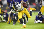 Pittsburgh Steelers running back Benny Snell tries to keep his balance while running with the ball against the Baltimore Ravens during the first half of an NFL football game, Sunday, Dec. 29, 2019, in Baltimore. (AP Photo/Nick Wass)