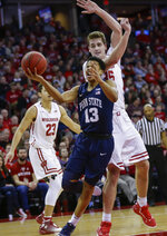 Penn State's Rasir Bolton (13) shoots against Wisconsin's Nate Reuvers (35) during the first half of an NCAA college basketball game Saturday, March 2, 2019, in Madison, Wis. (AP Photo/Andy Manis)