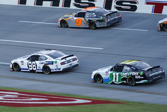 Justin Haley (11) runs behind Chase Briscoe (98) and Noah Gragson (9) during a NASCAR Xfinity Series auto race at Talladega Superspeedway, Saturday, Oct. 3, 2020, in Talladega, Ala. (AP Photo/John Bazemore)