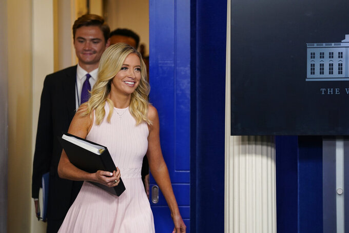 White House press secretary Kayleigh McEnany arrives to hold a press briefing at the White House, Monday, July 13, 2020, in Washington. (AP Photo/Evan Vucci)