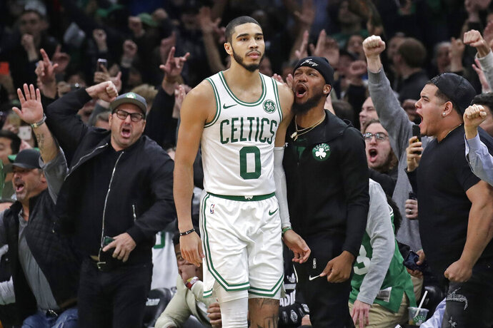Fans cheer after Boston Celtics forward Jayson Tatum (0) hit a jump shot in the finals seconds in the team's NBA basketball game against the New York Knicks, Friday, Nov. 1, 2019, in Boston. The Celtics won 104-102. (AP Photo/Elise Amendola)