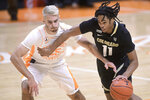 Tennessee's Santiago Vescovi (25) defends against Colorado's Keeshawn Barthelemy (11) during an NCAA college basketball game Tuesday, Dec. 8, 2020, in Knoxville, Tenn. (Caitie McMekin/Knoxville New-Sentinel via AP, Pool)