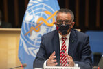 "In this photo released by WHO, World Health Organisation on Monday, Oct. 5, 2020,  WHO Director-General, Dr Tedros Adhanom Ghebreyesus, wearing a mask to protect against coronavirus, gestures during a special session on the COVID-19 respnse. The head of emergencies at the World Health Organization says its ""best estimates"" indicate that roughly 1 in 10 people worldwide may have been infected by the coronavirus.  (Christopher Black/WHO via AP)"