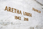 In this Sept. 5, 2018 photo, Aretha Franklin's crypt is shown at the Woodlawn Cemetery mausoleum in Detroit, Wednesday, Sept. 5, 2018. Regardless of her reputation as a performer, Aretha Franklin's cancer doctors say she was no diva as a patient. Two oncologists who treated the Queen of Soul say she handled her diagnosis and treatment with grace _ and the grit to keep performing for years. Franklin, who died in Detroit on Aug. 16, 2018, at 76, had pancreatic neuroendocrine cancer. It's a rare disease that differs from the more common, aggressive type of pancreatic cancer known as adenocarcinoma. (AP Photo/Paul Sancya)