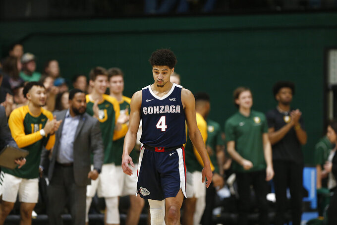 Gonzaga guard Ryan Woolridge (4) reacts during the first half of an NCAA college basketball game against San Francisco in San Francisco, Saturday, Feb. 1, 2020. (AP Photo/Jed Jacobsohn)