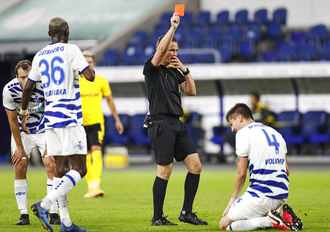 Referee Robert Kampka shows a red card to Duisburg's Dominic Volkmer during the 1st round German Soccer Cup match between MSV Duisburg and Borussia Dortmund in Duisburg, Germany, Monday, Sept. 14, 2020. (AP Photo/Martin Meissner)