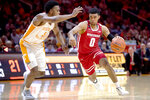 Wisconsin guard D'Mitrik Trice (0) dribbles around Tennessee guard Josiah-Jordan James (5) during an NCAA college basketball game, Saturday, Dec. 28, 2019 in Knoxville, Tenn. on Saturday, Dec. 28, 2019. (Calvin Mattheis/Knoxville News Sentinel via AP)