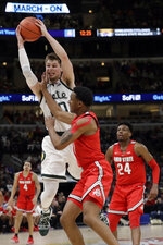 Michigan State's Matt McQuaid (20) grads a rebound against Ohio State's C.J. Jackson (3) during the first half of an NCAA college basketball game in the quarterfinals of the Big Ten Conference tournament, Friday, March 15, 2019, in Chicago. (AP Photo/Nam Y. Huh)