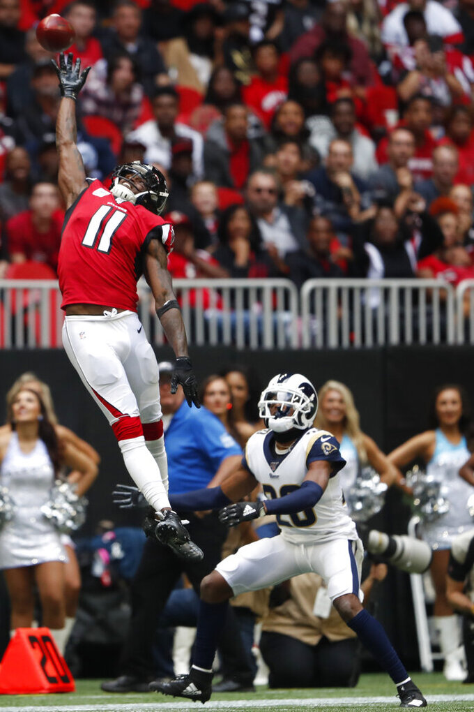 Atlanta Falcons wide receiver Julio Jones (11) misses the catch against Los Angeles Rams defensive back Marqui Christian (26) during the first half of an NFL football game, Sunday, Oct. 20, 2019, in Atlanta. (AP Photo/John Bazemore)