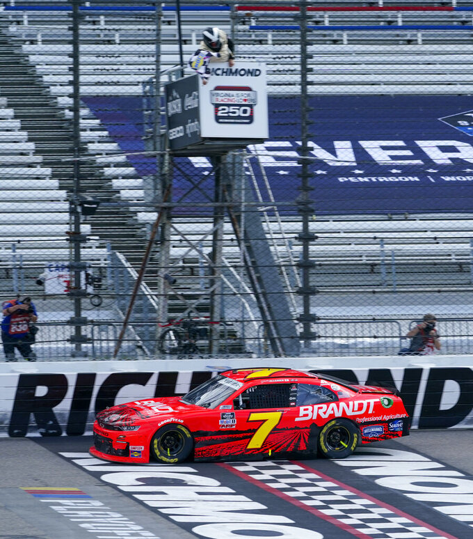 Justin Allgaier (7) crosses the finish line to win a NASCAR Xfinity Series auto race Saturday, Sept. 12, 2020, in Richmond, Va. Allgaier swept the two days of racing in the Xfinity Series. (AP Photo/Steve Helber)