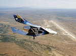 FILE - In this Friday, May 1, 2020 photo provided by Virgin Galactic, the SpaceshipTwo Unity flies free in New Mexico airspace for the first time. Founder Richard Branson is the only one of the three billionaires planning to launch himself _ from New Mexico, hopefully, by year's end _ before putting customers aboard. (Virgin Galactic via AP)
