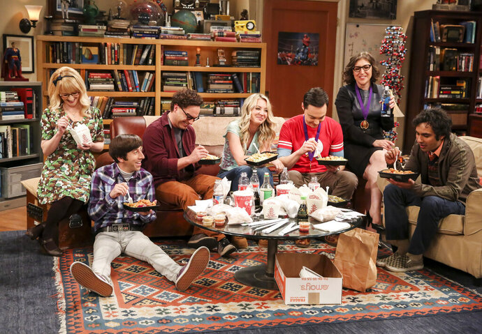 This photo provided by CBS shows Melissa Rauch, from left, Simon Helberg, Johnny Galecki, Kaley Cuoco, Jim Parsons, Mayim Bialik and Kunal Nayyar in a scene from the series finale of