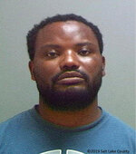 This booking photo provided by the Salt Lake County Sheriff's Office shows Ayoola A. Ajayi. Salt Lake City Police Chief Mike Brown said, Friday, June 28, 2019, that Ajayi was being charged with aggravated murder, kidnapping and desecration of a body in the death of 23-year-old Mackenzie Lueck. (Salt Lake County Sheriff's Office via AP)