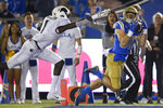 UCLA wide receiver Ethan Fernea, right, catches a pass for a touchdown past Colorado cornerback Delrick Abrams Jr. during the first half of an NCAA college football game in Los Angeles, Saturday, Nov. 2, 2019. (AP Photo/Kelvin Kuo)