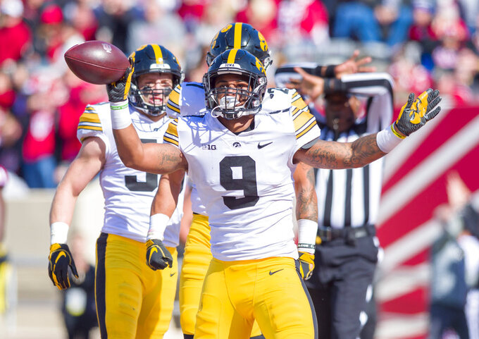 Iowa defensive back Geno Stone (9) reacts after catching an interception in the end zone during the second half of an NCAA college football game against Indiana, Saturday, Oct. 13, 2018, in Bloomington, Ind. Iowa won 42-16. (AP Photo/Doug McSchooler)