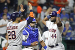 Houston Astros' Yordan Alvarez (44) celebrates with Robinson Chirinos (28) after hitting a three-run home run during the eighth inning of a baseball game against the Kansas City Royals on Saturday, Sept. 14, 2019, in Kansas City, Mo. (AP Photo/Charlie Riedel)