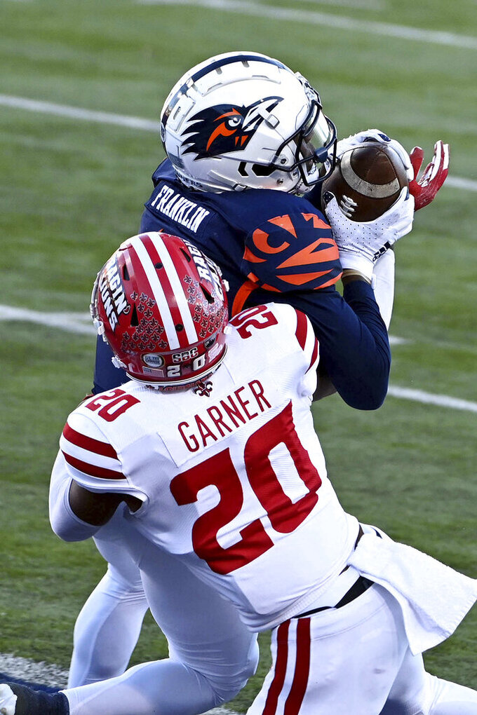 UTSA wide receiver Zakhari Franklin (18) catches a touchdown pass in front of Louisiana-Lafayette cornerback Mekhi Garner (20) in the third quarter during the First Responder Bowl NCAA college football game in Dallas, Saturday, Dec. 26, 2020. (AP Photo/Matt Strasen)
