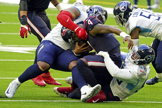 Tennessee Titans' Jeffery Simmons, left, and Harold Landry III (58) sack Houston Texans quarterback Deshaun Watson (4) during the first half of an NFL football game Sunday, Jan. 3, 2021, in Houston. (AP Photo/Sam Craft)