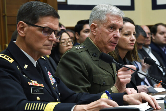U.S. Africa Command Commander Gen. Thomas Waldhauser, center, flanked by U.S. Central Command Commander Gen. Joseph Votel, left, and Acting Assistant Secretary of Defense for International Security Affairs Kathryn Wheelbarger, right, testifies before the House Armed Services Committee on Capitol Hill in Washington, Thursday, March 7, 2019. (AP Photo/Susan Walsh)