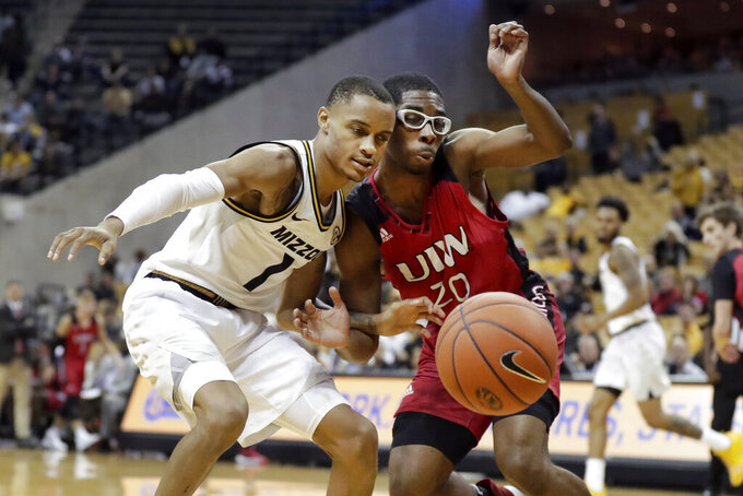 Missouri's Xavier Pinson (1) and Incarnate Word's Morgan Taylor (20) collide while watching the ball during the second half of an NCAA college basketball game Wednesday, Nov. 6, 2019, in Columbia, Mo. (AP Photo/Jeff Roberson)