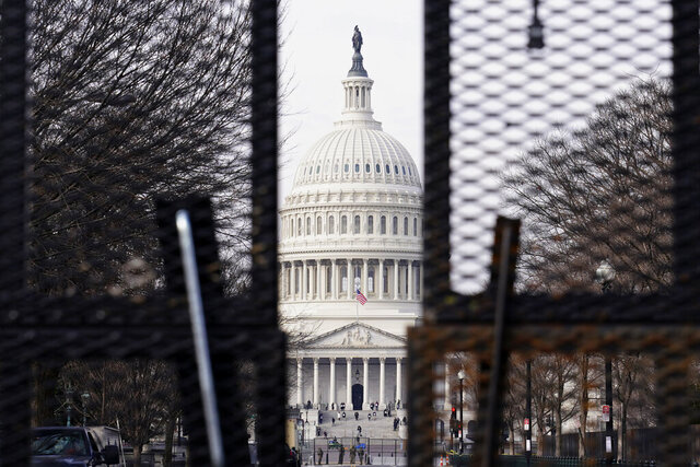 Security surrounds the U.S. Capitol in Washington, Friday, Jan. 15, 2021, ahead of the inauguration of President-elect Joe Biden and Vice President-elect Kamala Harris. (AP Photo/Susan Walsh)