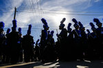 """In this Monday, Jan. 15, 2018 photo, C.E. King High School band members wait to perform in the MLK Grande Parade in Houston. For more than two decades, competing MLK Day parades have been held in Houston. This year, the city of Houston threw its official support behind one parade, the 41st annual """"Original"""" MLK, Jr. Parade, hoping the city could unite behind only one parade. But organizers of the other parade, the 25th annual MLK Grande Parade, will still be holding its event and they say they have no plans to stop having their own parade. (Michael Ciaglo/Houston Chronicle via AP)"""