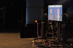 A video image is shown at right in a TVW studio during a debate between Sen. Marko Liias, D-Lynnwood, left, and U.S. Rep. Denny Heck, D-Wash., right, Thursday, Oct. 22, 2020, in Olympia, Wash., in the race for lieutenant governor of Washington state. (AP Photo/Ted S. Warren)