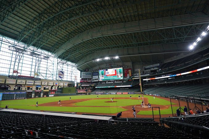 The Houston Astros play a simulated baseball game inside Minute Maid Park Thursday, July 9, 2020, in Houston. (AP Photo/David J. Phillip)