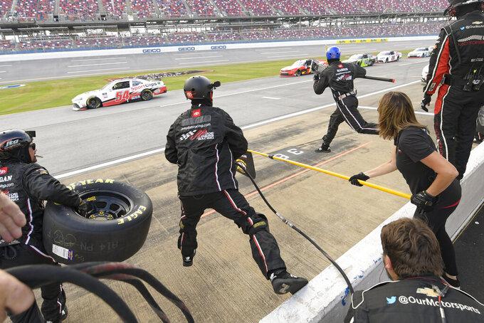 Crew members work as Myatt Snider pit stops during a NASCAR Xfinity Series auto race Saturday, Oct. 2, 2021, in Talladega, Ala. (AP Photo/John Amis)