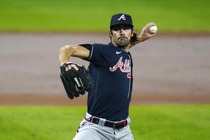 FILE - In this Wednesday, Sept. 16, 2020 file photo, Atlanta Braves starting pitcher Cole Hamels throws a pitch to the Baltimore Orioles during the second inning of a baseball game in Baltimore. Four-time All-Star Cole Hamels signed a one-year contract Wednesday, Aug. 4, 2021 with the Los Angeles Dodgers through the end of the season, adding more depth to a pitching staff that has been racked with injuries.(AP Photo/Julio Cortez, File)