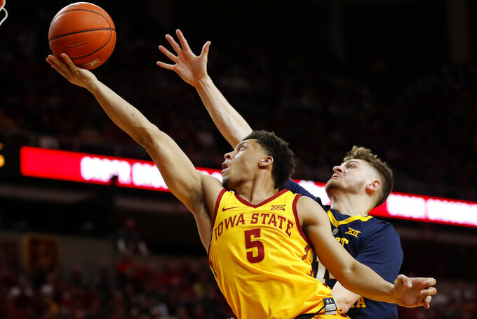 Iowa State guard Lindell Wigginton (5) drives to the basket past West Virginia guard Chase Harler during the second half of an NCAA college basketball game Wednesday, Jan. 30, 2019, in Ames, Iowa. (AP Photo/Charlie Neibergall)