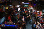 People fill a bar during the Sturgis Motorcycle Rally, Friday, Aug. 7, 2020, in Sturgis, S.D., amid the coronavirus pandemic. (AP Photo/Stephen Groves)
