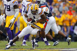 LSU wide receiver Ja'Marr Chase (1) is tackled on a pass reception in the first half of an NCAA college football game against Auburn in Baton Rouge, La., Saturday, Oct. 26, 2019. (AP Photo/Gerald Herbert)