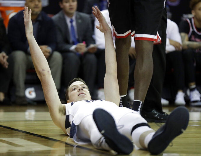 Utah State's Justin Bean reacts after falling to the court during the first half of the team's NCAA college basketball game against Fresno State in the Mountain West Conference men's tournament Friday, March 15, 2019, in Las Vegas. (AP Photo/Isaac Brekken)