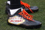 FILE - This Oct. 8, 2017, file photo, shows cleats of Cincinnati Bengals cornerback Dre Kirkpatrick honoring the victims of the mass shooting in Las Vegas, before an NFL football game against the Buffalo Bills in Cincinnati. The NFL is planning to allow players to have decals on the back of their helmets bearing names or initials of victims of systemic racism and police violence. The league has been in talks with individual players and their union since June about somehow honoring such victims.(AP Photo/Frank Victores, File)